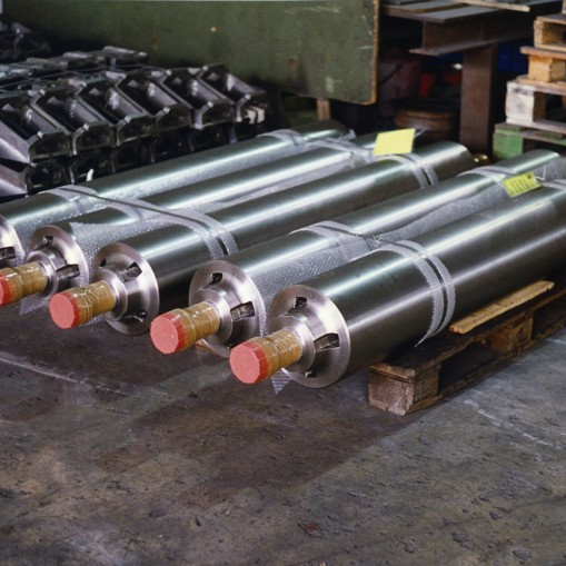 Wrapper rollers for coilers